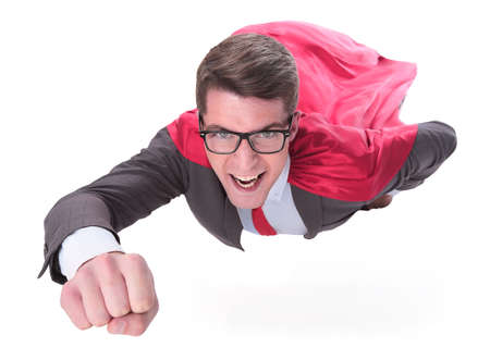 confident superhero businessman is flying to you