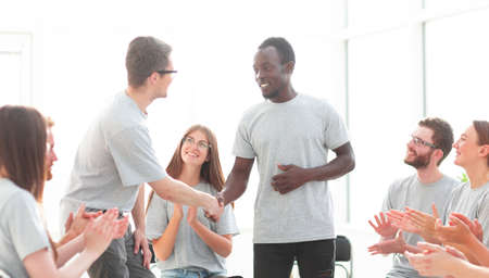 new friends shaking hands during the workshop.