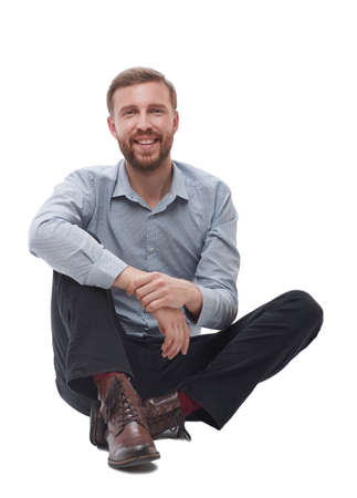in full growth.tired businessman sitting on the floor