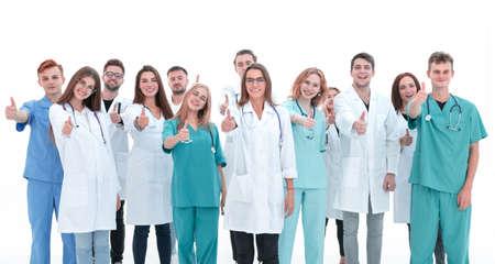 Ansicht von oben. eine Gruppe lächelnder Ärzte, die in die Kamera schaut. Standard-Bild