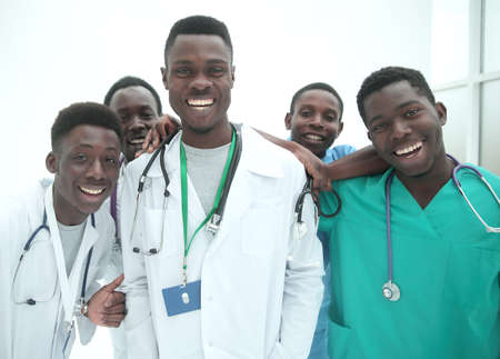 in full growth. smiling young doctors standing one by one Imagens