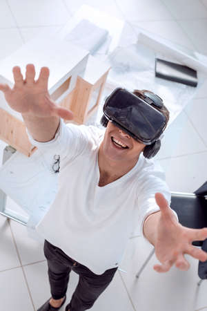 close up. architect in a virtual reality helmet in the creative Studio