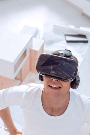 architect in a virtual reality helmet in the creative Studio