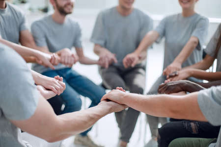 close up. a group of people holding each others hands Stock Photo
