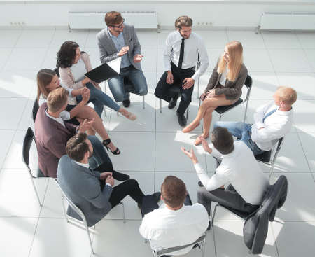 top view. business training participants sitting in a circle and looking at the camera Stock Photo