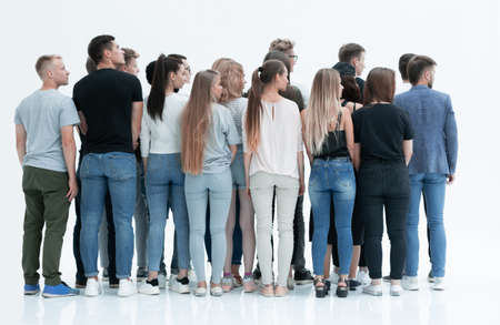 rear view. a group of young people looking in one direction