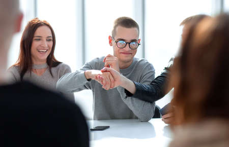 young people shaking hands at a group meeting. Stockfoto