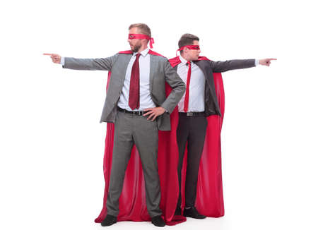two businessmen in superhero raincoats pointing in different directions.