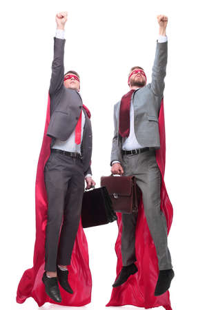 two business leaders in superhero capes starting out together Stock Photo