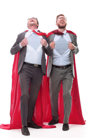two business colleagues in red capes standing in Superhero pose