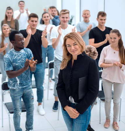 top view. a group of casual young people applauding together Stock Photo