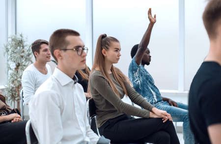 diverse young people applauding while sitting in the same row Stock Photo