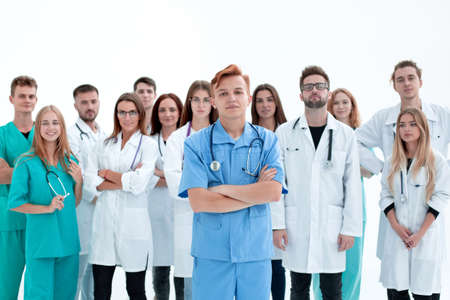 young Intern doctor standing in front of his senior colleagues