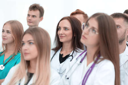 close up. a group of medical professionals putting their hands together