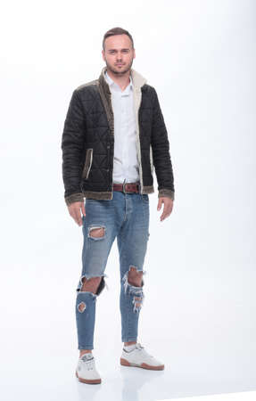 stylish young man in fashionable jeans . isolated on white