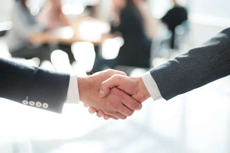 close up. business handshake on an office background. photo with copy-space