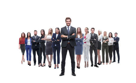 leader standing on the background of a large business team Фото со стока