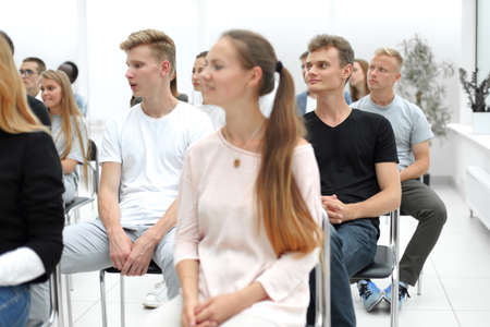 group of diverse young people sitting in a conference room Stockfoto