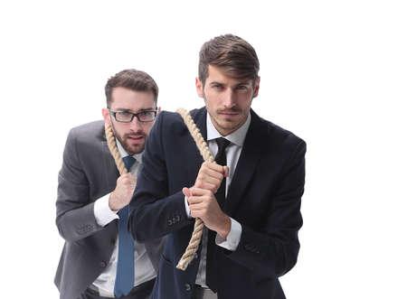 full length . two businessmen pulling a long rope. 写真素材