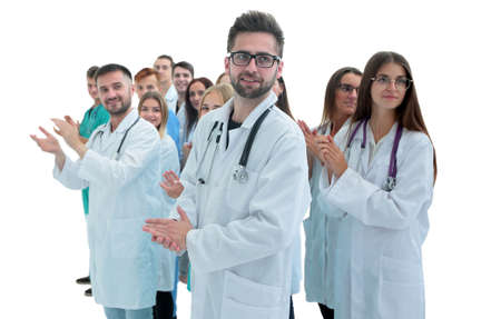 confident head standing ahead of young medical colleagues