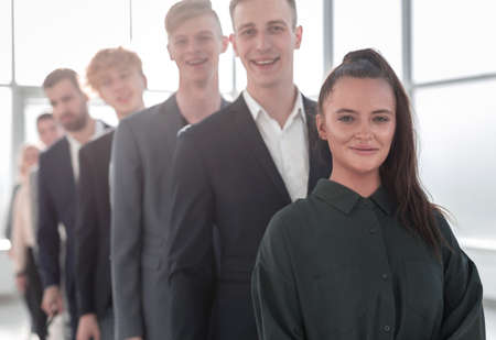 close up. young business people standing in line.