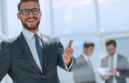 smiling businessman welcome handshake