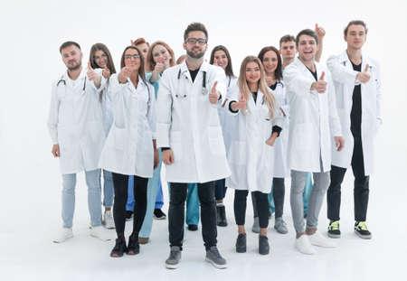 large group of diverse doctors giving a thumbs up