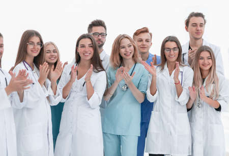 close up. a group of different doctors applauds together.