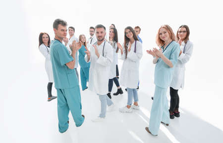 team of diverse doctors applauding their joint success