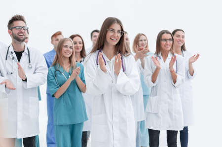 group of young doctors give a standing ovation