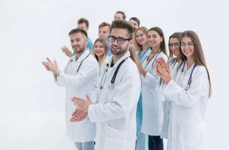 side view. a group of applauding doctors looking at the camera Stock Photo