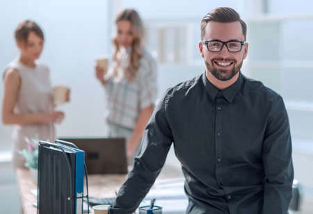 smiling young business man standing in office