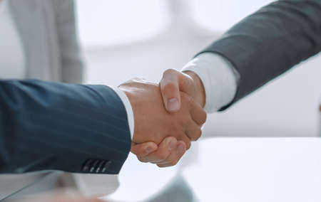 closeup.handshake of business partners after signing the contract.