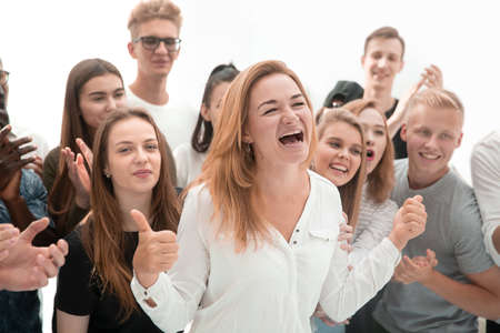 group of young people supporting their happy leader