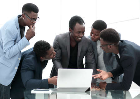 serious business team looking at laptop screen