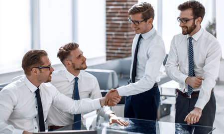 handshake colleagues in the workplace