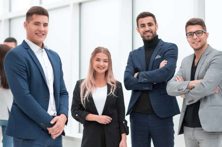 group of ambitious young employees standing in the office.