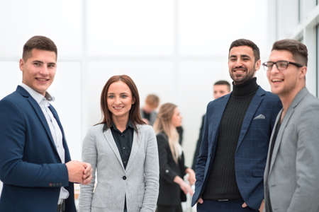 group of diverse employees standing in the office
