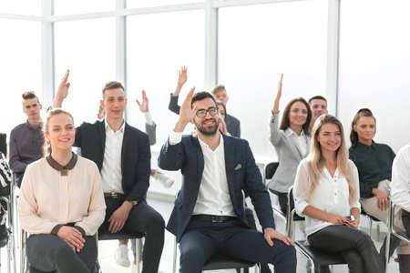 group of employees asking questions during a business meeting Banco de Imagens