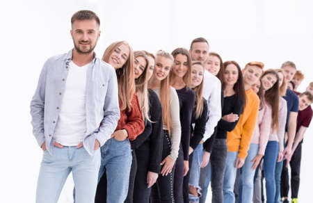 handsome guy standing in front of a group of young people