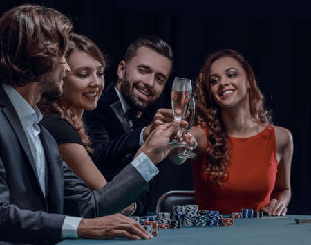 friends drinking and celebrating a gambling night Фото со стока