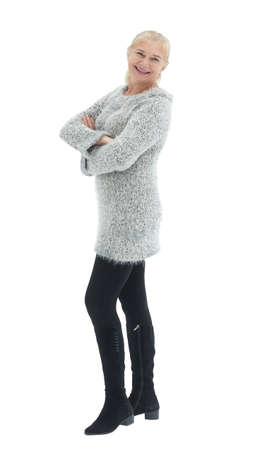 Happy casual woman standing isolated over a white background