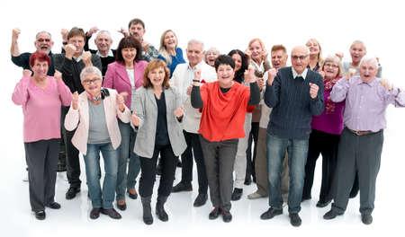 Groupe de personnes âgées levant la main pour célébrer une victoire Banque d'images