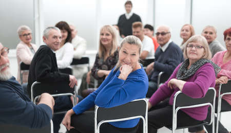 Adult people listen to the motivational speech of the lecturer Stock fotó