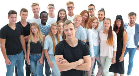 confident guy standing in front of a group of young people