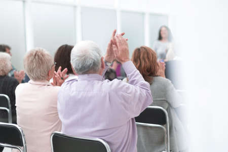 Rear view of a senior people listening a lecture
