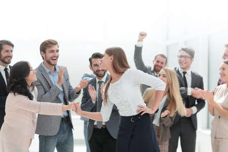happy employees congratulating their leader. the concept of victory