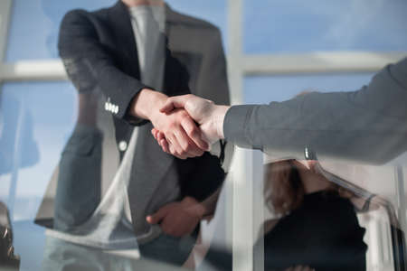 shaking hands while working for teamwork and cooperation concept after finish an agreement in the office construction site, success collaboration concept