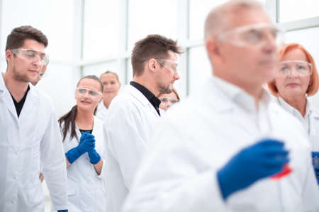group of researchers working on a new vaccine.