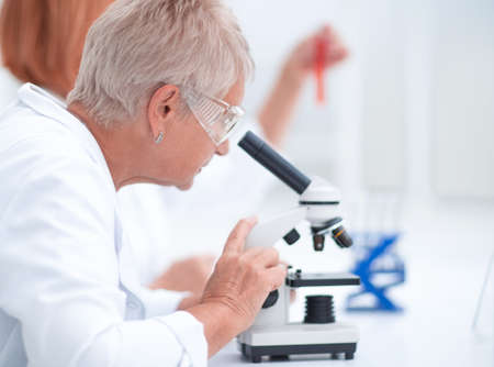 female scientist conducts research in the laboratory.